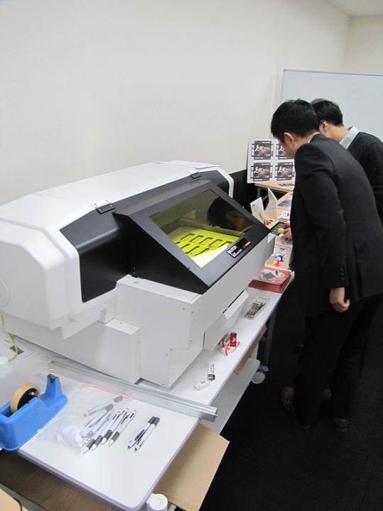ヨコハマシステムズ2014大阪展示会場の様子-武藤工業様のUVプリンター